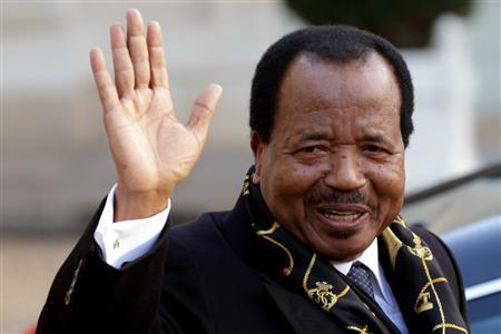Cameroon's President Paul Biya waves as he leaves following a meeting at the Elysee Palace in Paris, January 30, 2013. REUTERS/Philippe Wojazer