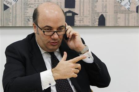 Banca Monte Paschi di Siena CEO Fabrizio Viola talks on his mobile phone during a news conference in downtown Milan January 28, 2013. REUTERS/Alessandro Garofalo