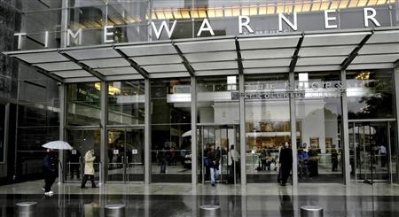 People walk in front of the Time Warner Inc. headquarters building at Columbus Circle in New York in this file photo taken October 13, 2005. REUTERS/Nicholas Roberts/Files (UNITED STATES - Tags: BUSINESS REAL ESTATE)
