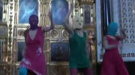 Members of the female punk band ''Pussy Riot'' stage a protest inside Christ The Saviour Cathedral in Moscow in this still image taken from file video February 21, 2012. REUTERS/Pussy Riot Group/Reuters TV/Handout/Files