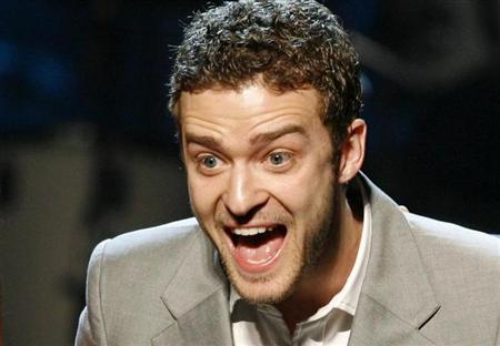 Singer Justin Timberlake reacts as he holds two of his awards for songs ''My Love'' and ''Until the End of Time'' during the 25th Annual ASCAP Pop Music Awards at the Kodak Theatre in Hollywood, California, April 9, 2008. REUTERS/Danny Moloshok