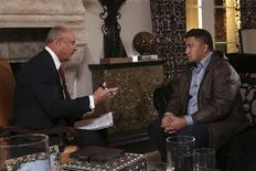 Dr. Phil McGraw (L) interviews Ronaiah Tuiasosopo on the set of his show in this January 2013 handout photo obtained by Reuters January 30, 2013. REUTERS/CBS Television Distribution / Peteski Productions/Handout