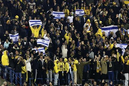 Supporters of Beitar Jerusalem cheer for their team during a soccer match against Maccabi Umm el-Fahm at Teddy Stadium in Jerusalem January 29, 2013. REUTERS/Nir Elias