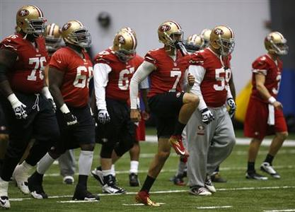 San Francisco 49ers quarterback Colin Kaepernick (7) leads his team in stretching during practice for the Super Bowl in New Orleans, January 30, 2013. Super Bowl XLVII will be played between the San Francisco 49ers and the Baltimore Ravens on February 3. REUTERS/Jeff Haynes