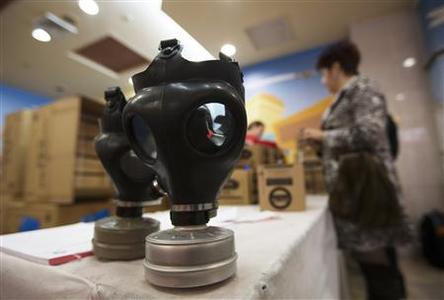 Gas masks are seen on a table at a distribution point at a shopping mall in Pisgat Zeev, an urban settlement in an area Israel annexed to Jerusalem after capturing it in the 1967 Middle East war, January 30, 2013. REUTERS/Ronen Zvulun