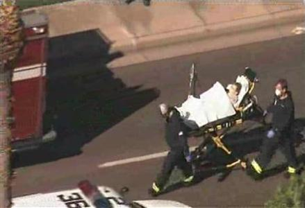 First responders wheel a person on a stretcher from the scene of a shooting in Phoenix, Arizona, January 30, 2013, in this still image taken from video courtesy of KTVK. At least three people were shot on Wednesday at a business complex, with one in extremely critical condition, police said. REUTERS/KTVK/Handout