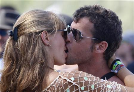 A couple kiss during Budapest's Sziget music festival on an island in the Danube River August 9, 2012. REUTERS/Bernadett Szabo
