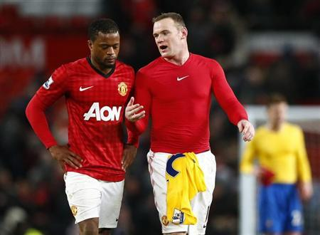 Manchester United's Wayne Rooney (R) and Patrice Evra react after their English Premier League soccer match against Southampton at Old Trafford in Manchester, northern England, January 30, 2013. REUTERS/Darren Staples