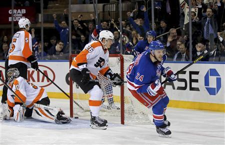 New York Rangers right wing Ryan Callahan (24) celebrates in front of Philadelphia Flyers left wing Ruslan Fedotenko (26) and goalie Ilya Bryzgalov (30) after he scored in the second period of their NHL hockey game at Madison Square Garden in New York January 29, 2013. REUTERS/Ray Stubblebine