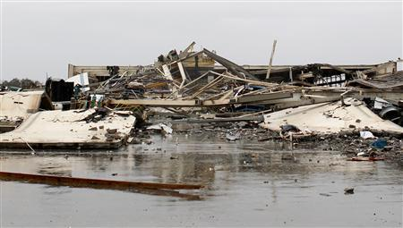 The Daiki Corporation building lays in ruin after being levelled by a tornado in Adairsville, Georgia, January 30, 2012. Tornadoes were reported in four states killing two people including one in Adairsville as an Artic cold front clashed with warm air producing severe weather over a wide swath of the nation. REUTERS/Tami Chappell