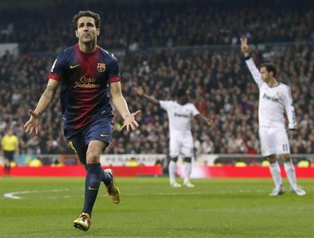 Barcelona's Cesc Fabregas celebrates a goal against Real Madrid during their Spanish King's Cup semi final first leg soccer match at Santiago Bernabeu stadium in Madrid, January 30, 2013. REUTERS/Juan Medina