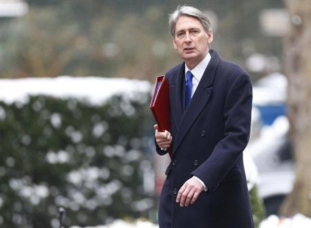 Britain's Defence Secretary Philip Hammond arrives to attend a Cabinet meeting at 10 Downing Street in central London, January 22, 2013. REUTERS/Andrew Winning