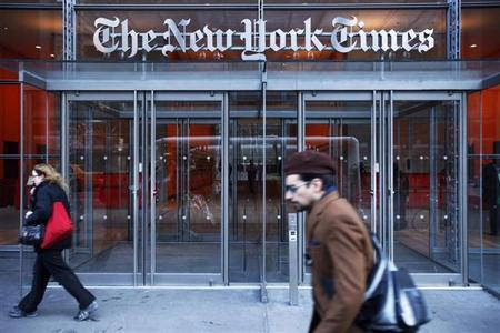 Pedestrians walk past the New York Times headquarters in New York March 1, 2010. REUTERS/Lucas Jackson/Files