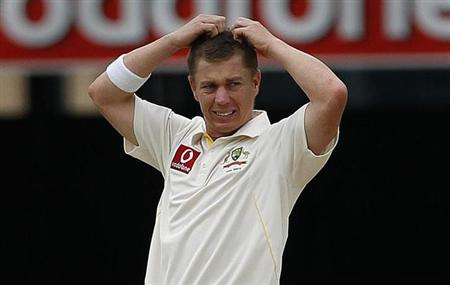 Australia's Xavier Doherty reacts while bowling during the first Ashes test in Brisbane November 28, 2010. REUTERS/Daniel Munoz/Files