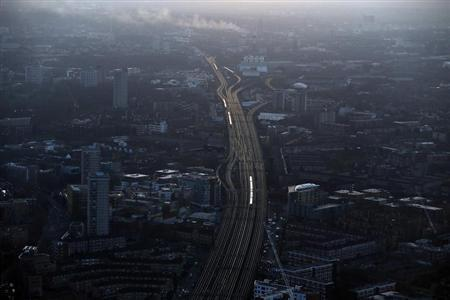 Commuter trains are seen at dawn on the approach to London Bridge rail station in an aerial photograph from The View gallery at the Shard, western Europe's tallest building, in London January 8, 2013. REUTERS/Stefan Wermuth