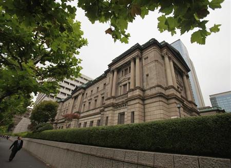 A man walks past the Bank of Japan headquarters building in Tokyo October 30, 2012. REUTERS/Yuriko Nakao