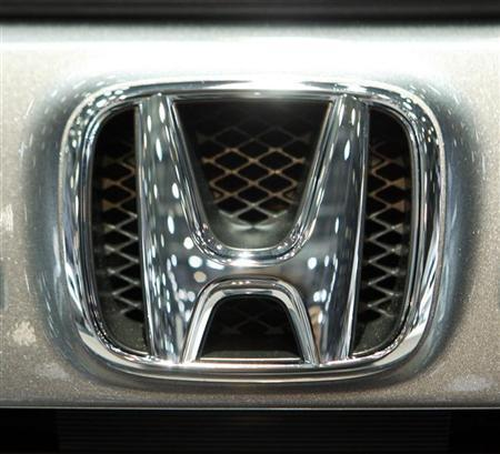 The Honda logo is displayed during the second media day of the 80th Geneva Car Show at the Palexpo in Geneva March 3, 2010. REUTERS/Valentin Flauraud/Files