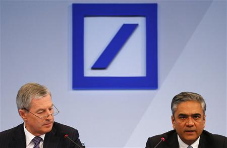 Co-Chairmen of Germany's largest business bank, Deutsche Bank, Anshu Jain (R ) and Juergen Fitschen address the media during the bank's annual news conference in Frankfurt, January 31, 2013. REUTERS/Kai Pfaffenbach