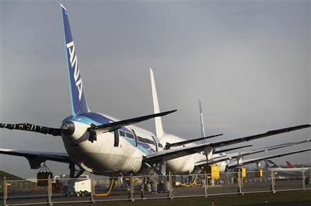 Boeing 787 Dreamliner jets, including two painted with All Nippon Airways (ANA) livery, sit idle on the tarmac parking at Paine Field in Everett, Washington in this January 17, 2013 file photo. REUTERS/Anthony Bolante/Files