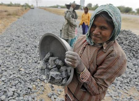 A labourer works at a road construction site in Ahmedabad January 30, 2013. REUTERS/Amit Dave