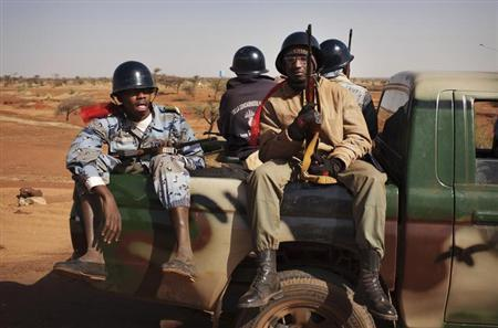 Malian soldiers heading to Gao in a pickup truck arrive in the recently liberated town of Douentza January 30, 2013. REUTERS/Joe Penney