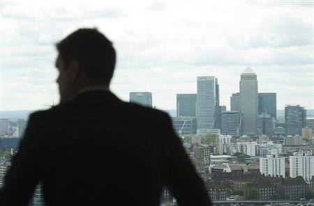 A man overlooks the Canary Wharf financial district from the top of the ArcelorMittal Orbit in the London 2012 Olympic Park in east London May 11, 2012. REUTERS/Ki Price