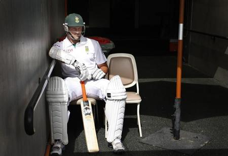 South Africa's Graeme Smith sits in the ground access tunnel at the Adelaide cricket ground before the third day's play of the second test cricket match against Australia November 24, 2012. REUTERS/Regi Varghese/Files