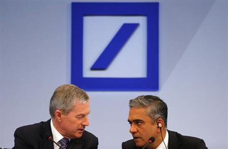 Co-Chairmen of Germany's largest business bank, Deutsche Bank, Anshu Jain (R ) and Juergen Fitschen address the media during the bank's annual news conference in Frankfurt, January 31,