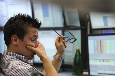 A trader reacts at his desk at the Frankfurt stock exchange August 11, 2011. REUTERS/Alex Domanski/Files