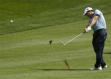 Richard Sterne of South Africa hits a shot from the eighth fairway during the first round of the Dubai Desert Classic at the Emirates Golf Club, January 31, 2013. REUTERS/Jumana El Heloueh