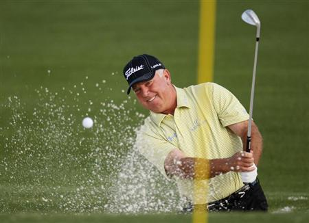 Former champion Mark O'Meara of the U.S. hits from a sand trap on the second green during second round play at the 2009 Masters golf tournament at the Augusta National Golf Club in Augusta, Georgia, April 10, 2009. REUTERS/Shaun Best
