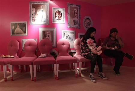 Customers eat dessert during the media preview of a Barbie-themed cafe in Taipei January 30, 2013. REUTERS/Pichi Chuang
