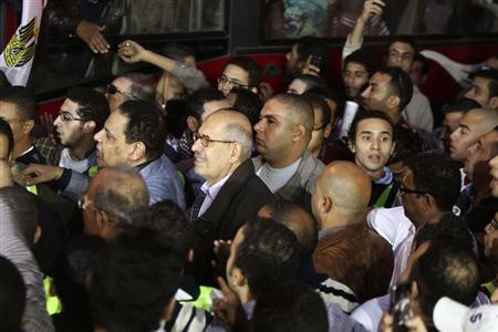 Nobel Peace Prize laureate and Adoustour party leader Mohamed ElBaradei (C) joins protesters during a march against President Mohamed Mursi's decree, at Shubra district in Cairo November 27, 2012. REUTERS/Mohamed Abd El Ghany/Files