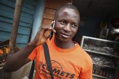 A man makes a call on a mobile phone in Sierra Leone's capital Freetown December 13, 2012. REUTERS/Simon Akam