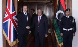 Libya's Prime Minister Ali Zeidan shakes hands with his British counterpart David Cameron (L) during a welcome session at the headquarters of the Prime Minister's Office in Tripoli January 31, 2013. REUTERS/Ismail Zitouny
