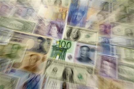 Arrangement of various world currencies including Chinese Yuan, Japanese Yen, US Dollar, Euro, British Pound, Swiss Franc and Russian Rouble pictured in Warsaw January 26, 2011. REUTERS/Kacper Pempel/Files