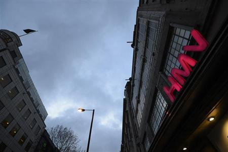 The sign of an HMV shop is illuminated in central London, January 15, 2013. REUTERS/Paul Hackett