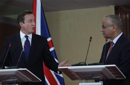 Britain's Prime Minister David Cameron (L) speaks during a joint news conference with Libya's Prime Minister Ali Zeidan, at the headquarters of the Prime Minister's Office, in Tripoli January 31, 2013. REUTERS/Ismail Zitouny
