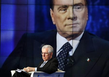 Italy's Prime Minister Mario Monti appears as a guest on the RAI television show Porta a Porta (Door to Door) in Rome in this January 14, 2013 file photo. Little more than a year ago Silvio Berlusconi was hounded out of office by a baying crowd and economics professor Mario Monti stepped in as prime minister, hailed as Italy's savior. Now Berlusconi has performed an astonishing comeback to return to the spotlight, exacting his political revenge while Monti is struggling badly to make a breakthrough in the campaign for a February 24-25 election. REUTERS/Alessandro Bianchi/Files
