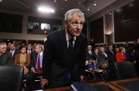 Former Sen. Chuck Hagel (R-NE) (L), sits down before giving testimony to the Senate Armed Services Committee to be Defense Secretary, on Capitol Hill in Washington, January 31, 2013. REUTERS/Kevin Lamarque