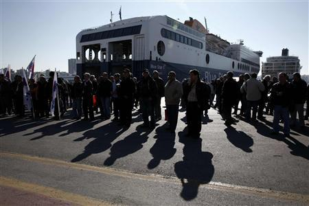 Seamen take part in a protest during the first day of a 48-hour strike at the port of Piraeus, near Athens January 31, 2013. REUTERS/Yorgos Karahalis