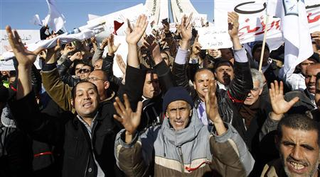 Tunisian police officers and security personnel chant slogans during a demonstration in Tunis January 31, 2013. Thousands of policemen protested outside the Tunisian prime minister's office on Thursday demanding better pay, equipment and protection, as the birthplace of the Arab Spring faces a growing security threat from radical Islamists. REUTERS/Zoubeir Souissi