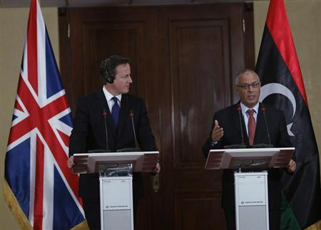 Libya's Prime Minister Ali Zeidan speaks during a joint news conference with Britain's Prime Minister David Cameron (L), at the headquarters of the Prime Minister's Office, in Tripoli January 31, 2013. REUTERS/Ismail Zitouny