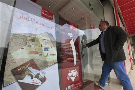 A customer enters the Asiacell company headquarters in Baghdad December 30, 2012. REUTERS/Saad Shalash