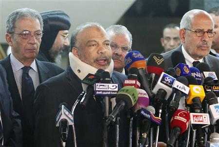 Saad al-Katatni, head of the Egyptian Muslim Brotherhood's Freedom and Justice party, talks during a news conference next to former Egyptian foreign minister Amr Moussa (L) and Egyptian liberal politician Mohamed ElBaradei (R) after their meeting in Cairo January 31, 2013. REUTERS/Asmaa Waguih