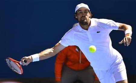 Jeremy Chardy of France hits a return to Juan Martin del Potro of Argentina during their men's singles match at the Australian Open tennis tournament in Melbourne January 19, 2013. REUTERS/Toby Melville