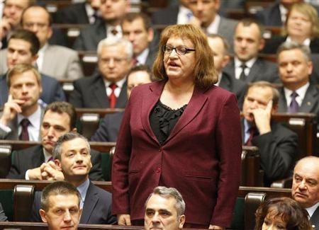 Anna Grodzka, first transsexual Polish lawmaker, from Palikot's Movement is sworn in during the first session of the Polish Parliament in Warsaw November 8, 2011. REUTERS/Peter Andrews