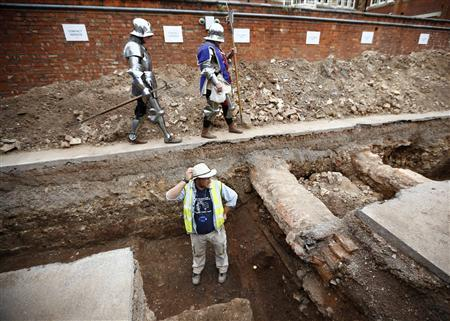 Archaeologist Mathew Morris stands in the trench where he found skeleton remains during an archaeological dig to find the remains of King Richard III in Leicester, central England in this file photograph dated September 12, 2012. REUTERS/Darren Staples/files