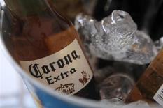 A bottle of Corona beer sits in a cooler at a bar in Cancun June 29, 2012. Anheuser Busch InBev, the world's biggest brewer, is taking over Mexico's Grupo Modelo for $20.1 billion, giving it dominance in Latin America's second-largest economy and adding Corona, the top-selling imported beer in the United States, to its brands. The long-awaited deal is the biggest foreign buyout of a Mexican company in more than 20 years and shows how much global brewers are willing to pay for developing market growth in an increasingly consolidated industry. REUTERS/Victor Ruiz Garcia (MEXICO - Tags: BUSINESS) - RTR34DN6