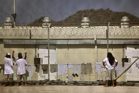 Detainees talk together inside the open-air yard at the Camp 4 detention facility at Guantanamo Bay U.S. Naval Base in Cuba, May 31, 2009. REUTERS/Brennan Linsley/Pool